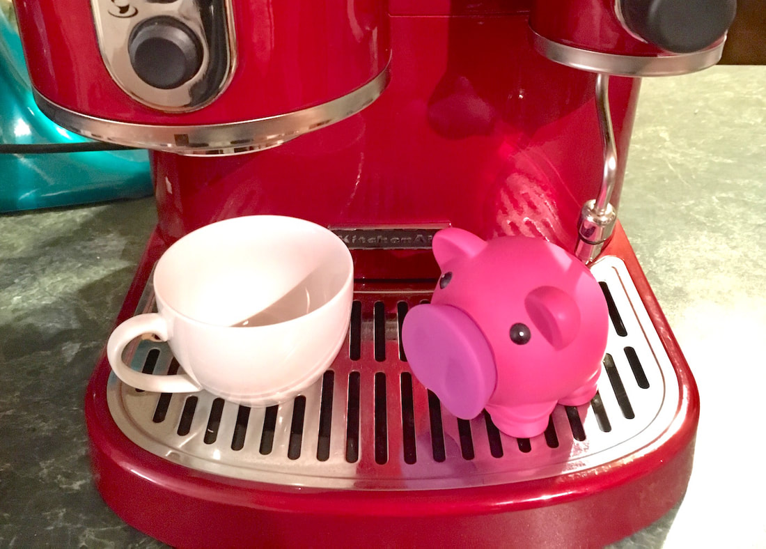 coffee cup and piggy bank - how to save for a deposit when you're renting